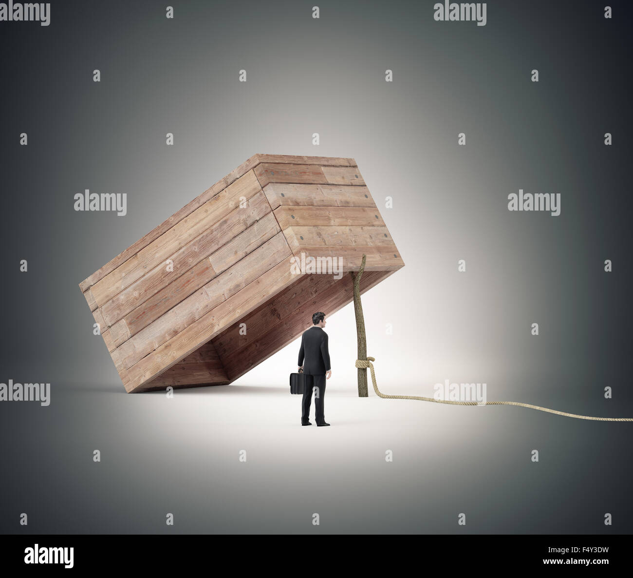 Businessman stranding next to a trap - Stock Image
