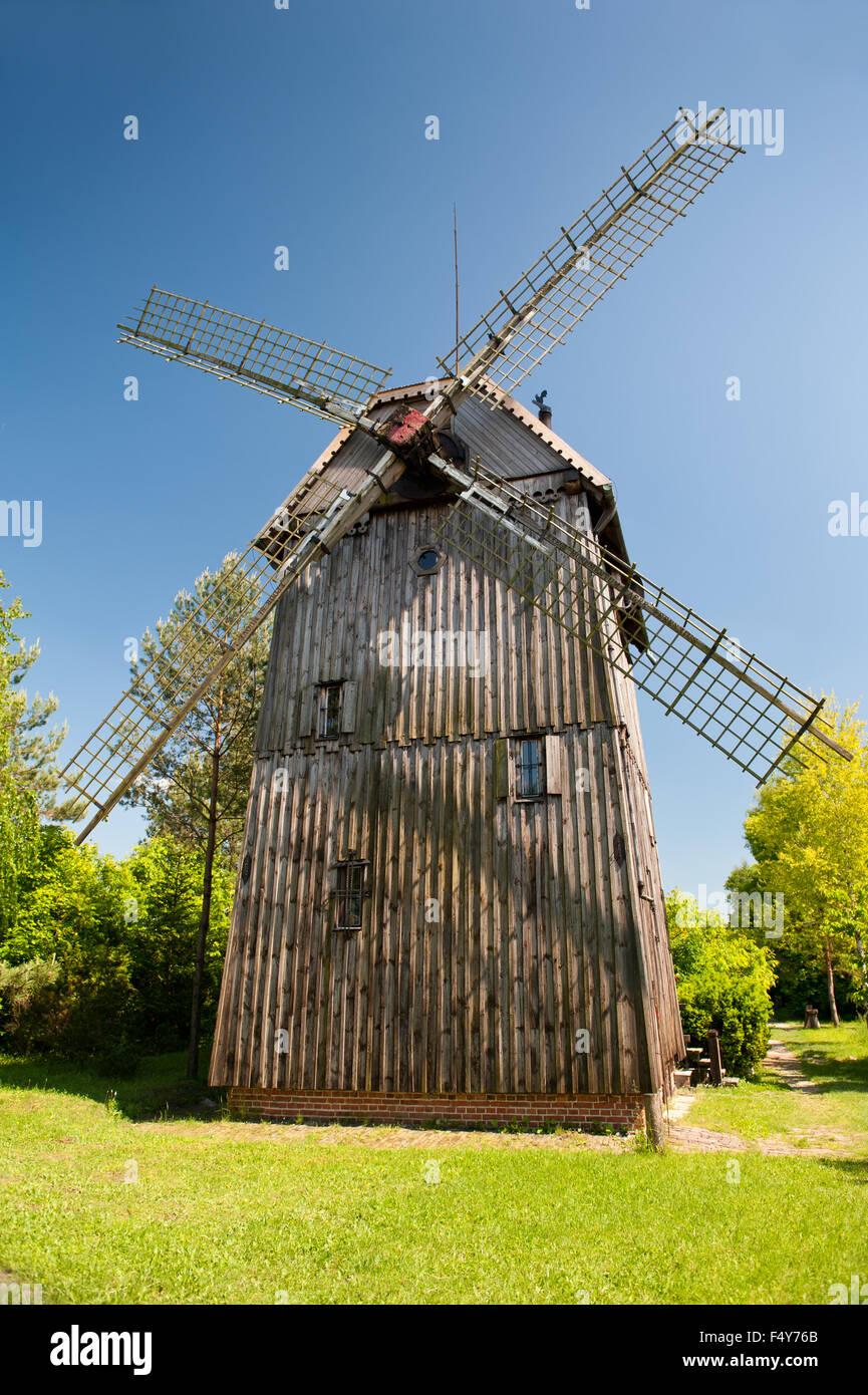 Wooden old windmill house building with blades in Mecmierz, Poland, Polish name drewniany wiatrak Kozlak, Wiatrak - Stock Image