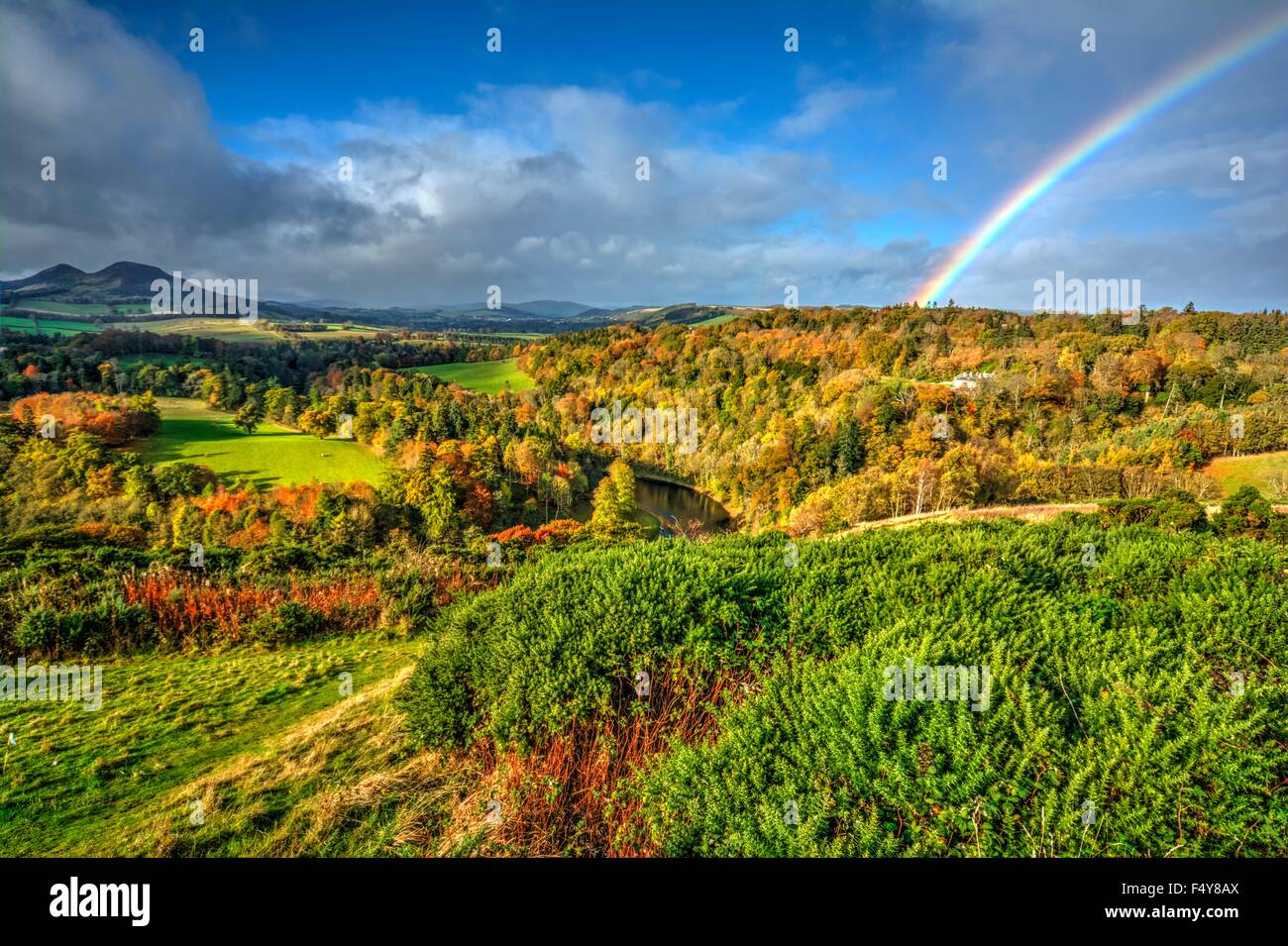 Autumn rainbow over Melrose, Scottish Borders - Stock Image