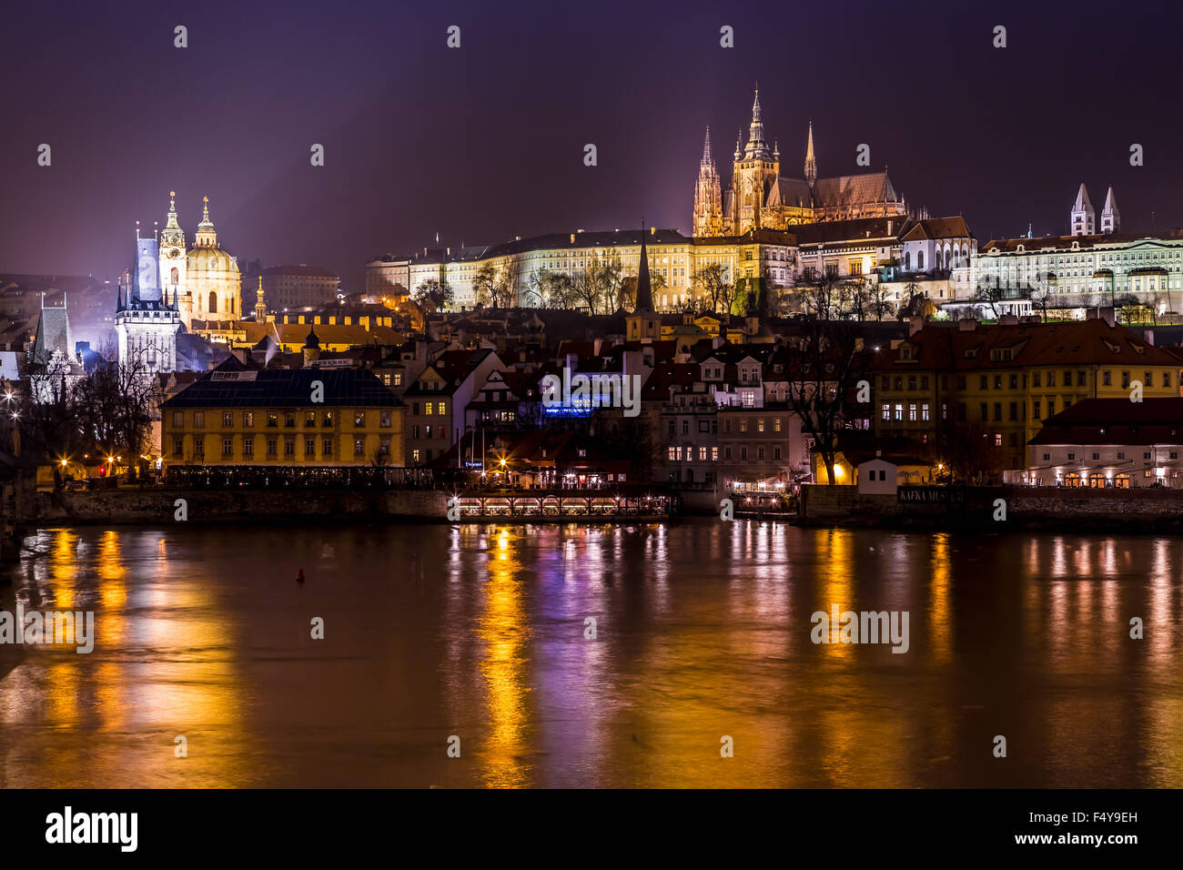 The View On Prague Gothic Castle With Charles Bridge In Night Czech Republic