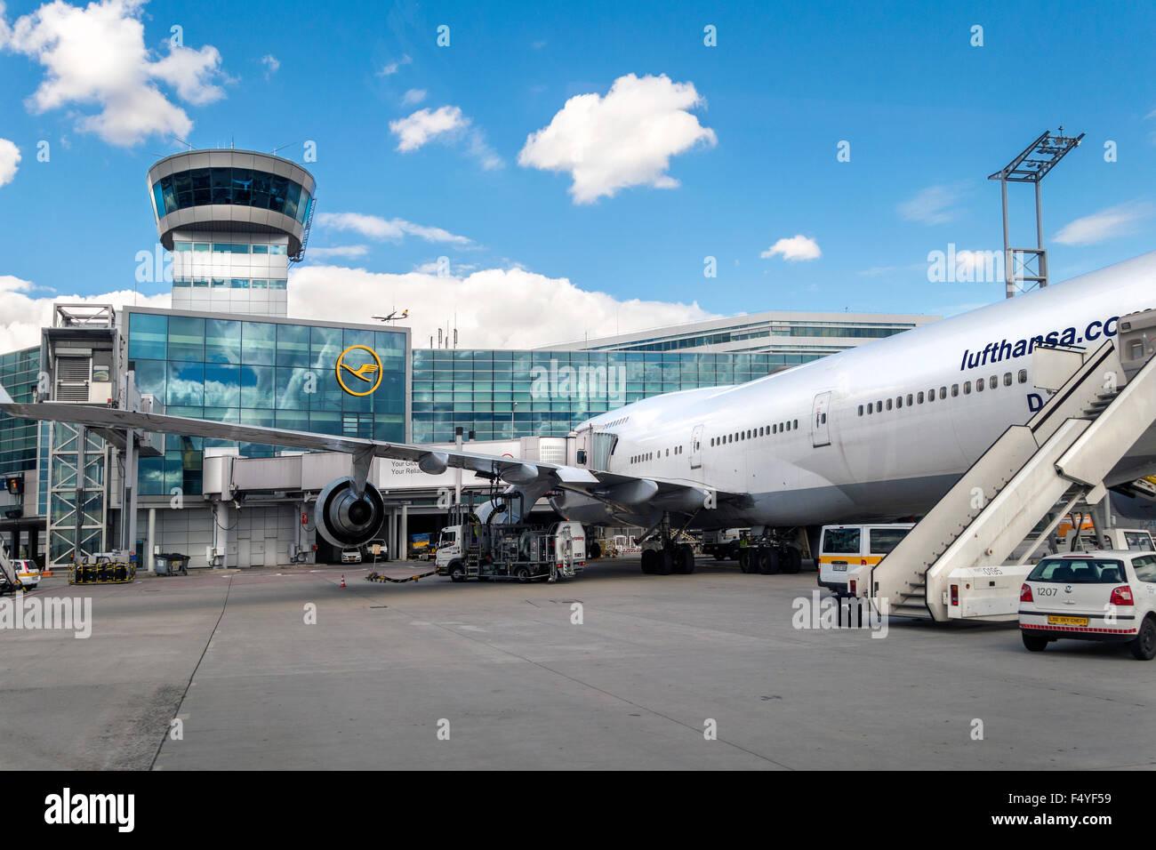 Frankfurt International Airport with Lufthansa Boeing 747 plane at the gate. - Stock Image