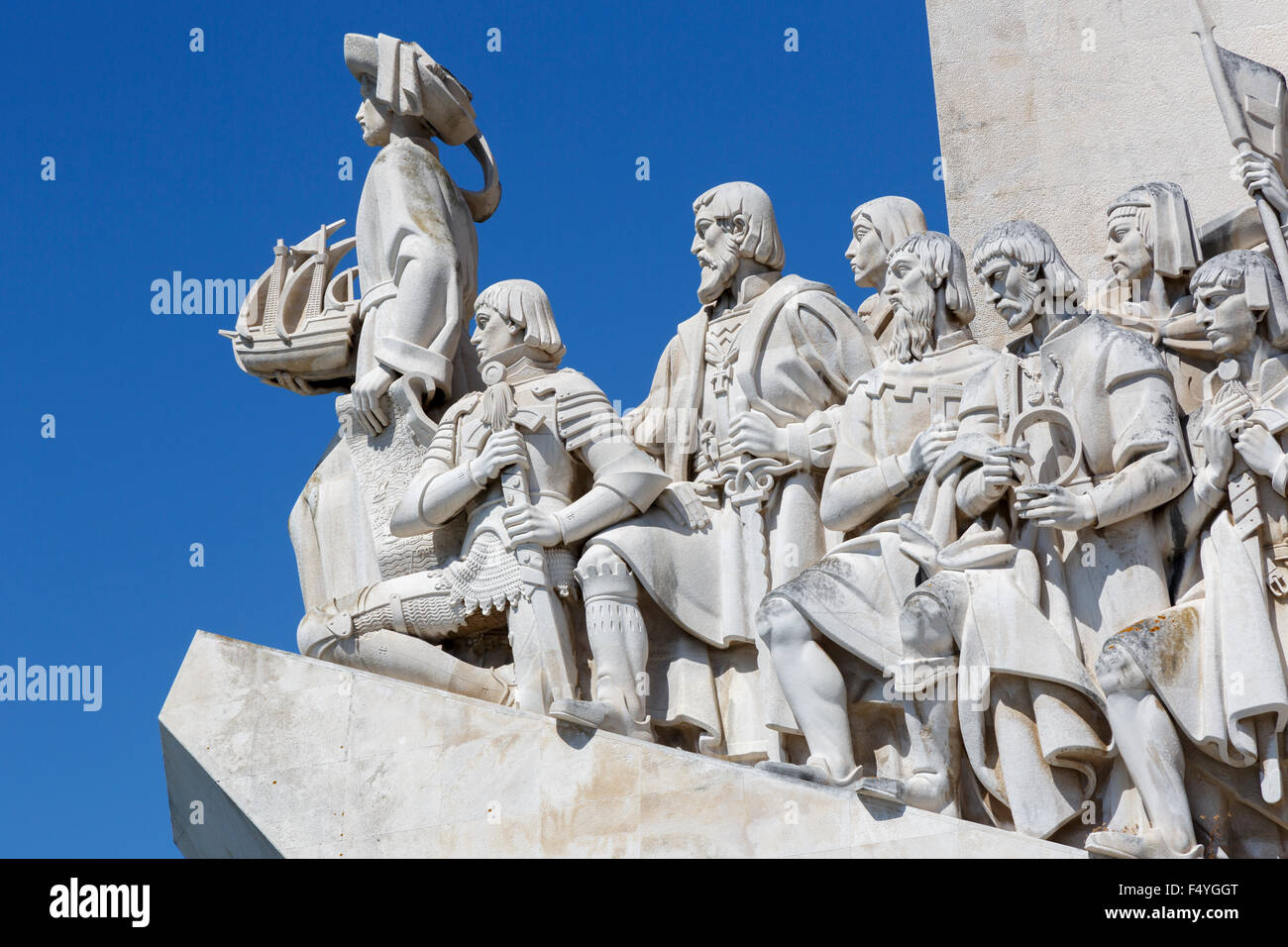 A close up of the Early Navigators on the Monument to the Discoveries (Padro dos Descobrimentos) against a clear - Stock Image
