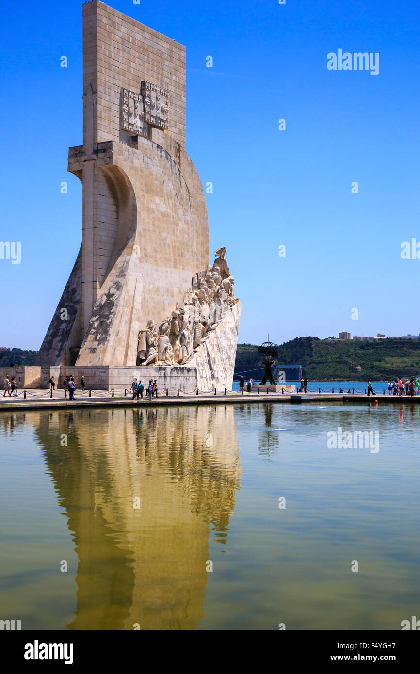 Monument to the Discoveries (Padrao dos Descobrimentos) against a clear blue sky and a reflection in the water Lisbon - Stock Image