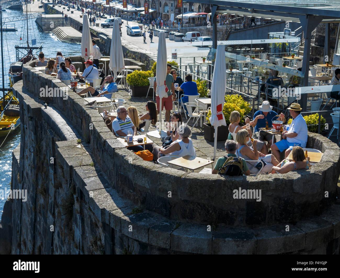 Visitors relaxing at Bar Ponte Pensil on the Cais da RIbeira Porto (Oporto) Portugal - Stock Image