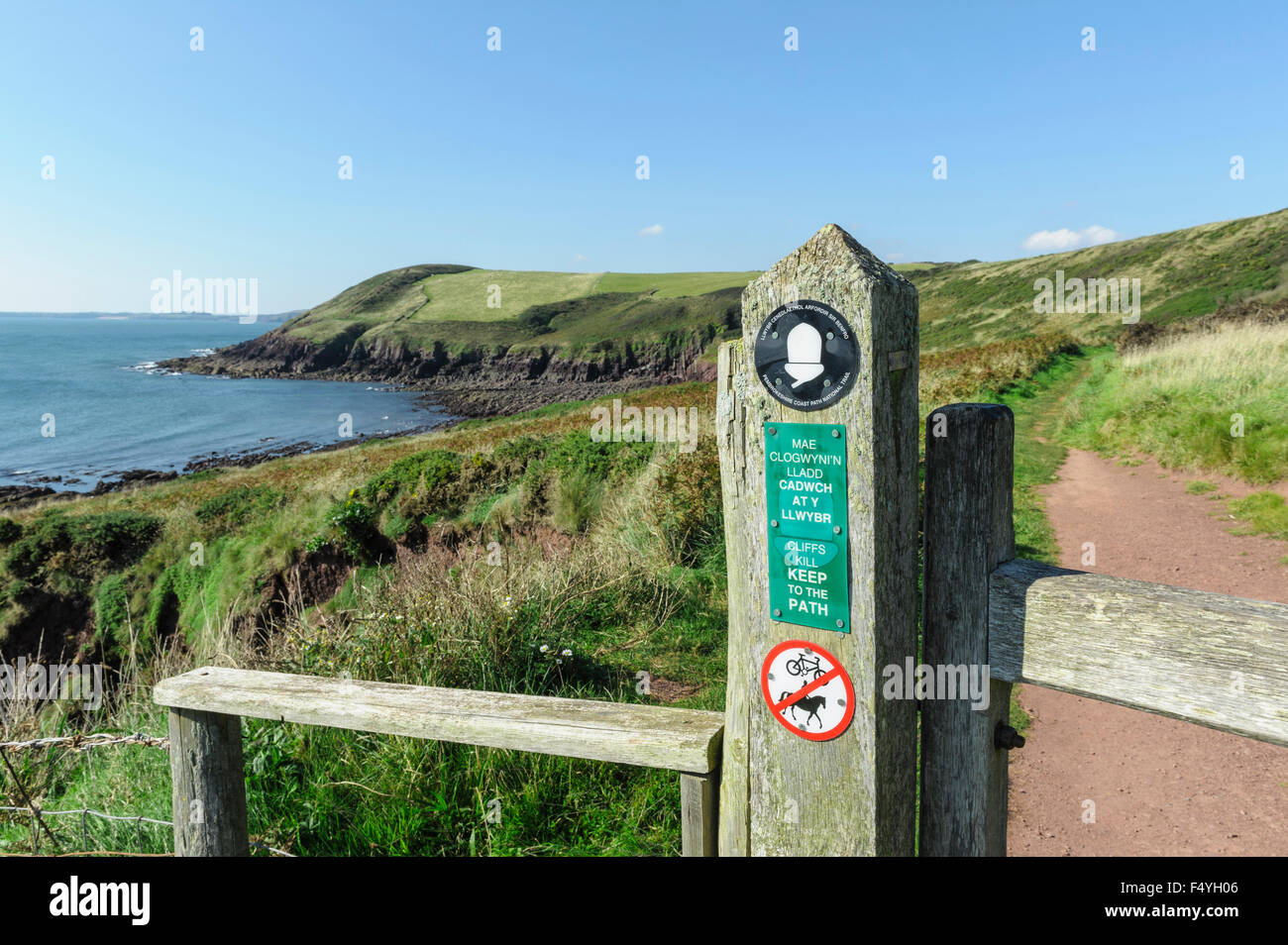 Signpost for the Pembrokeshire coast path. National park footpath sign.Trail. - Stock Image