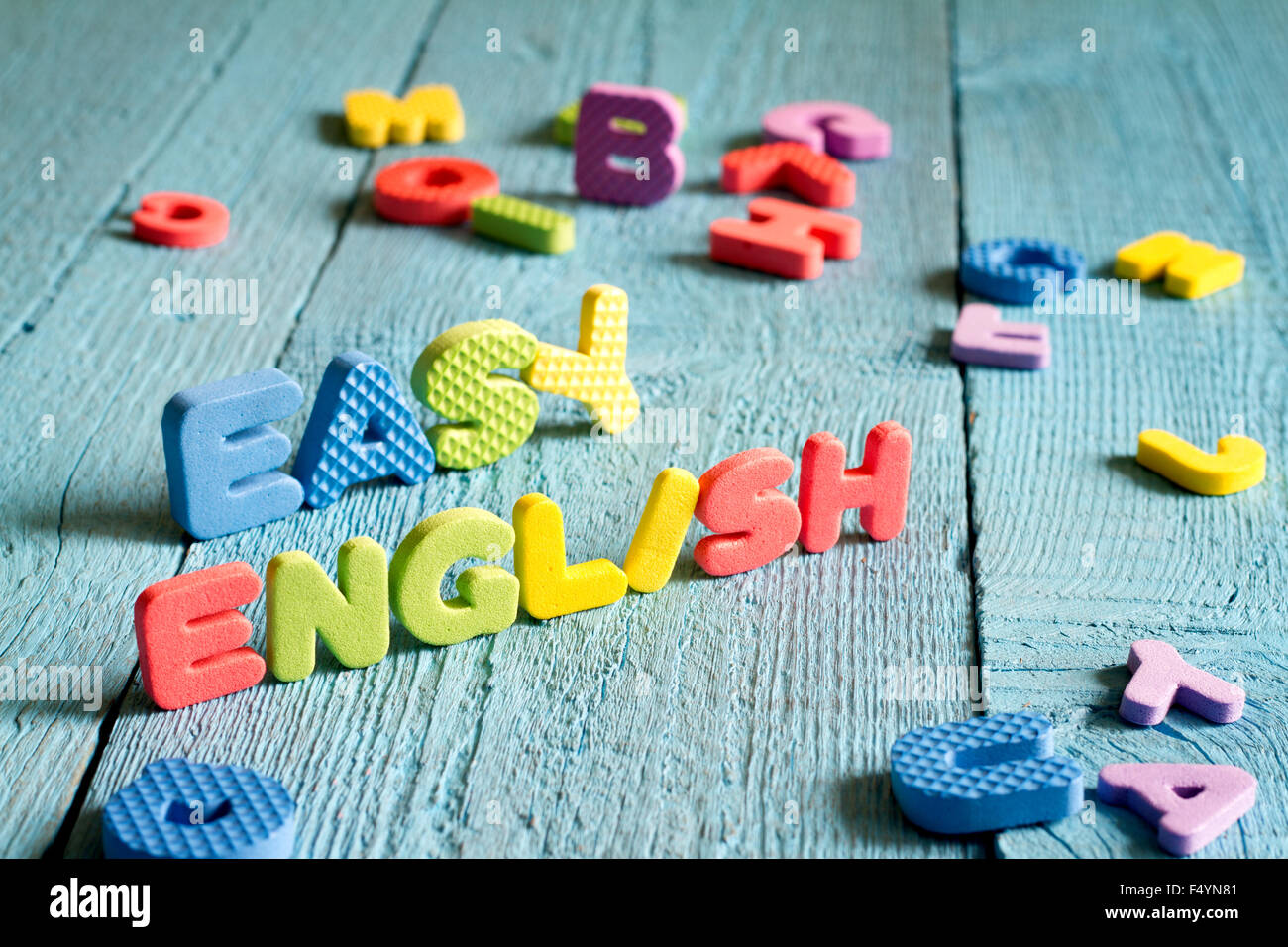 English is easy to learning concept with letters on blue boards concept - Stock Image