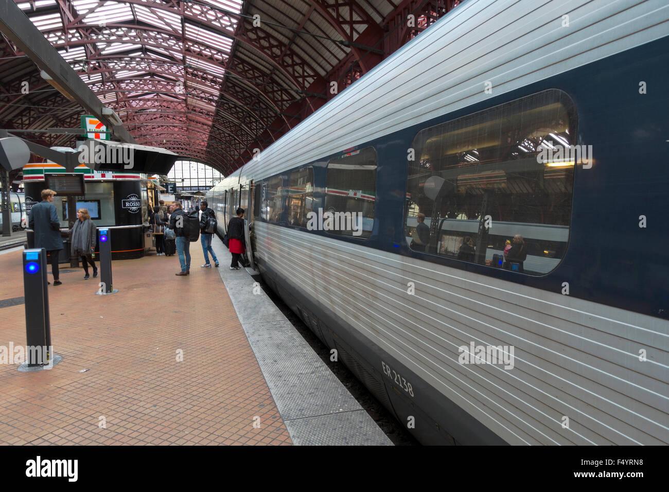 Regional train at platform at Copenhagen Central Station - Stock Image