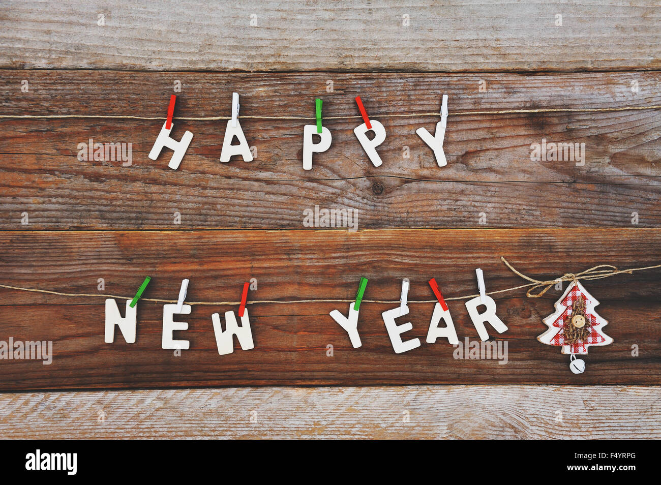 happy new year and christmas tree decoration on wooden background - Stock Image
