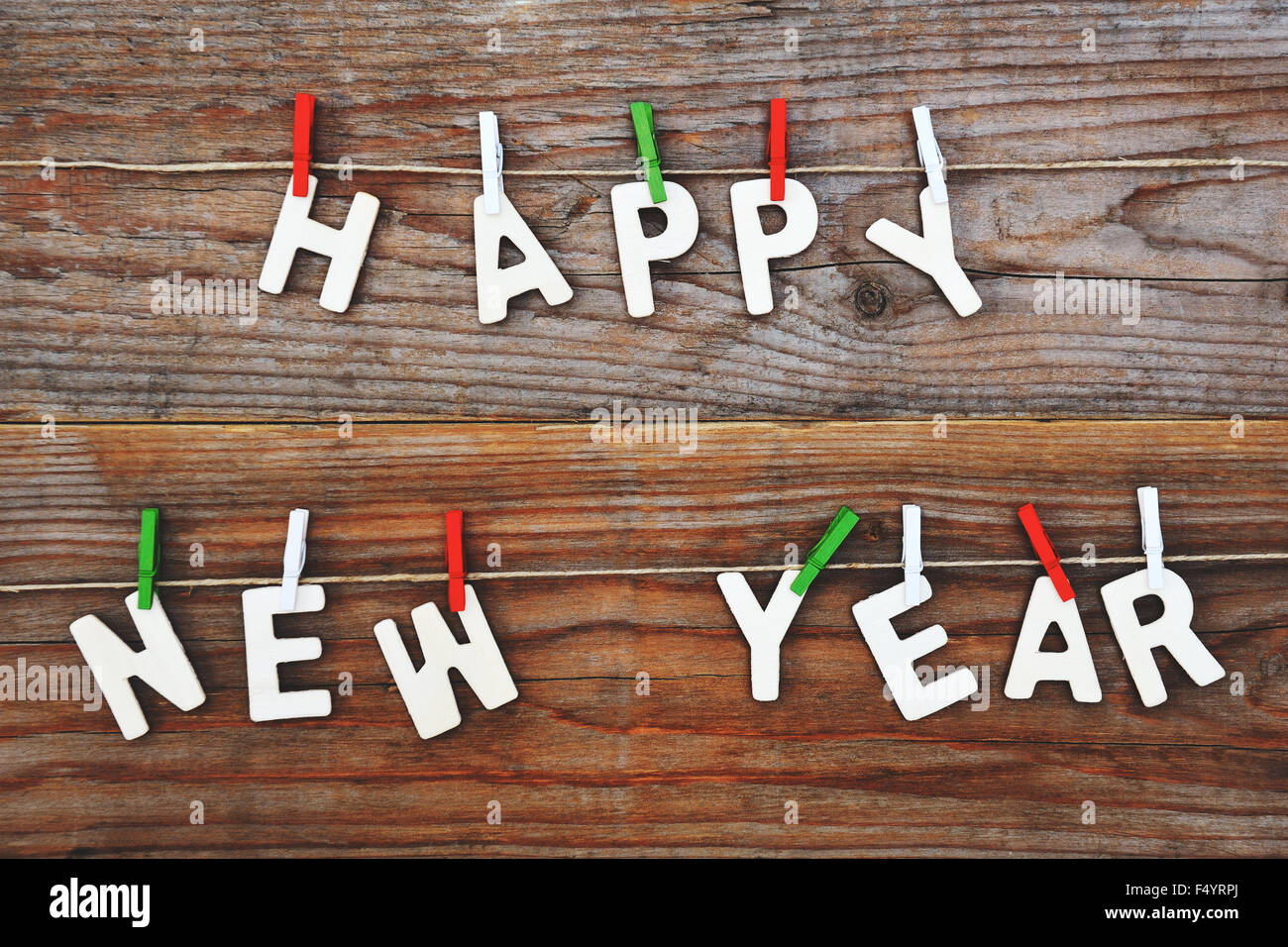 happy new year on wooden background - Stock Image