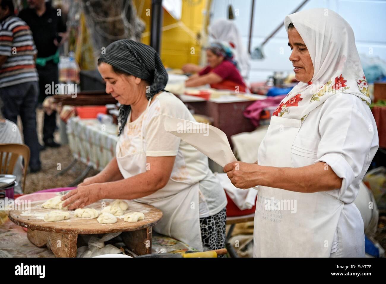 KAS Antalya Turkey Friday Market making traditional pancakes on a cast iron grill. - Stock Image