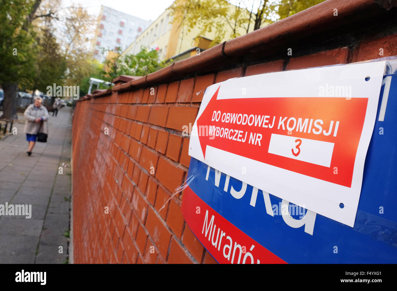 Warsaw, Poland - Sunday 25th October 2015 - National parliamentary election - Polling Station entrance  sign outside - Stock Image