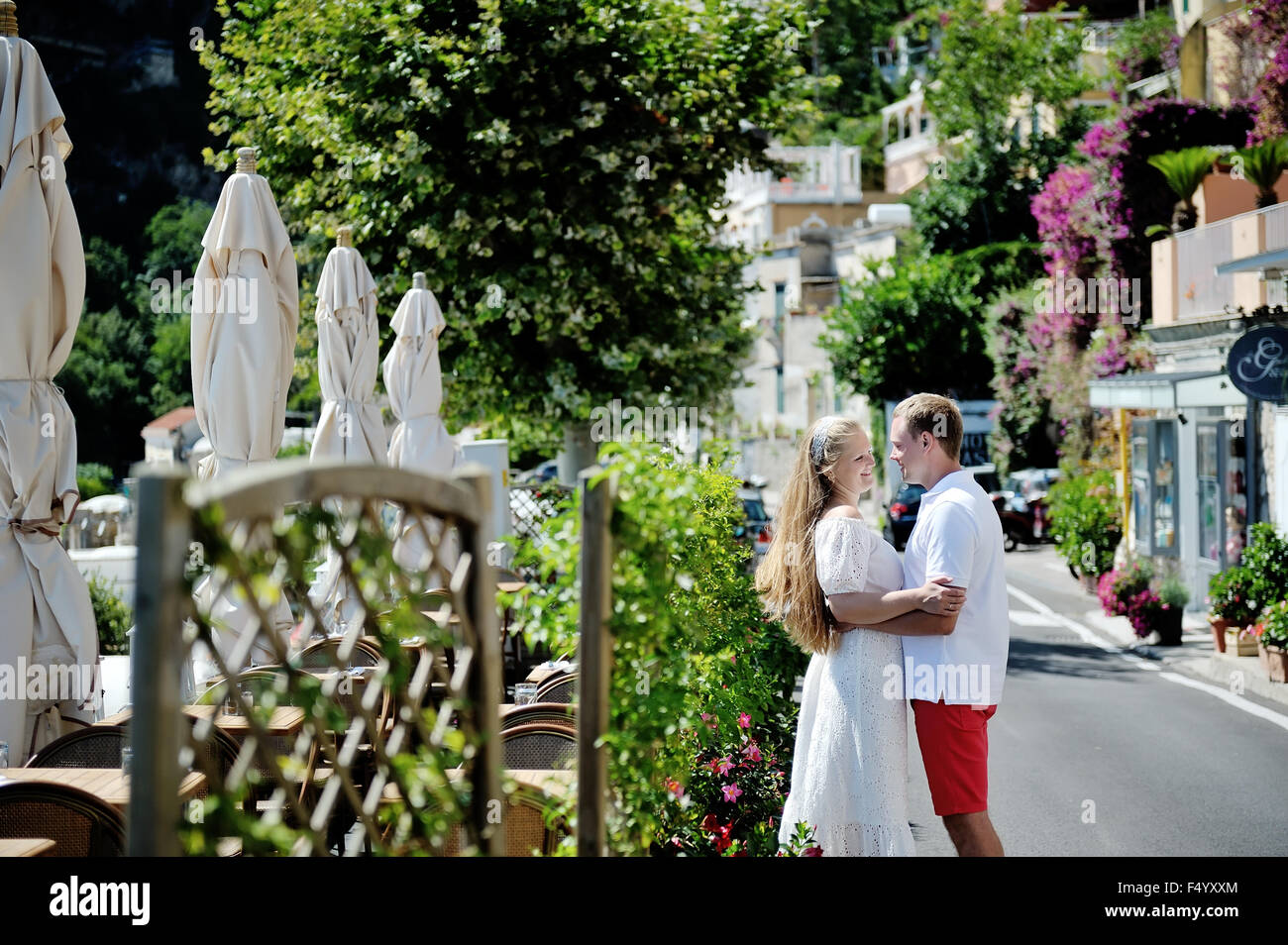 young couple tenderly embraced in a sunny day, Amalfi coast, Italy - Stock Image