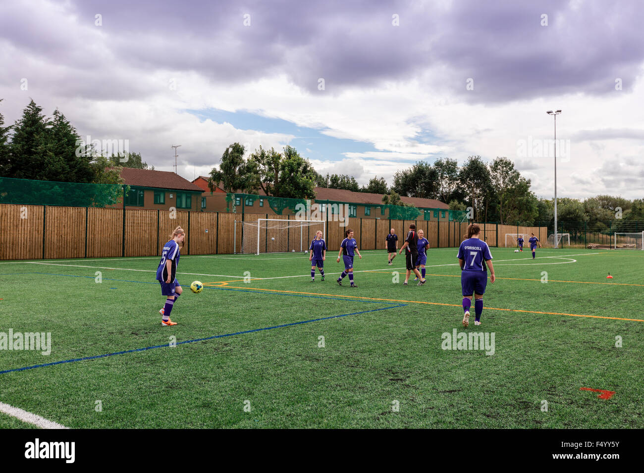 Female football team training session at the FC United football pitch in Manchester, UK. - Stock Image