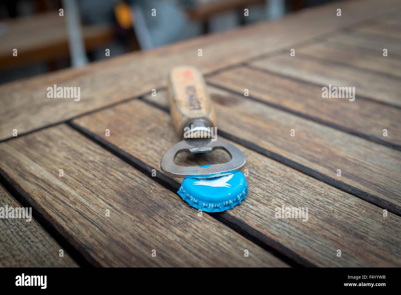 Bottle opener and Brewdog beer bottle cap - Stock Image