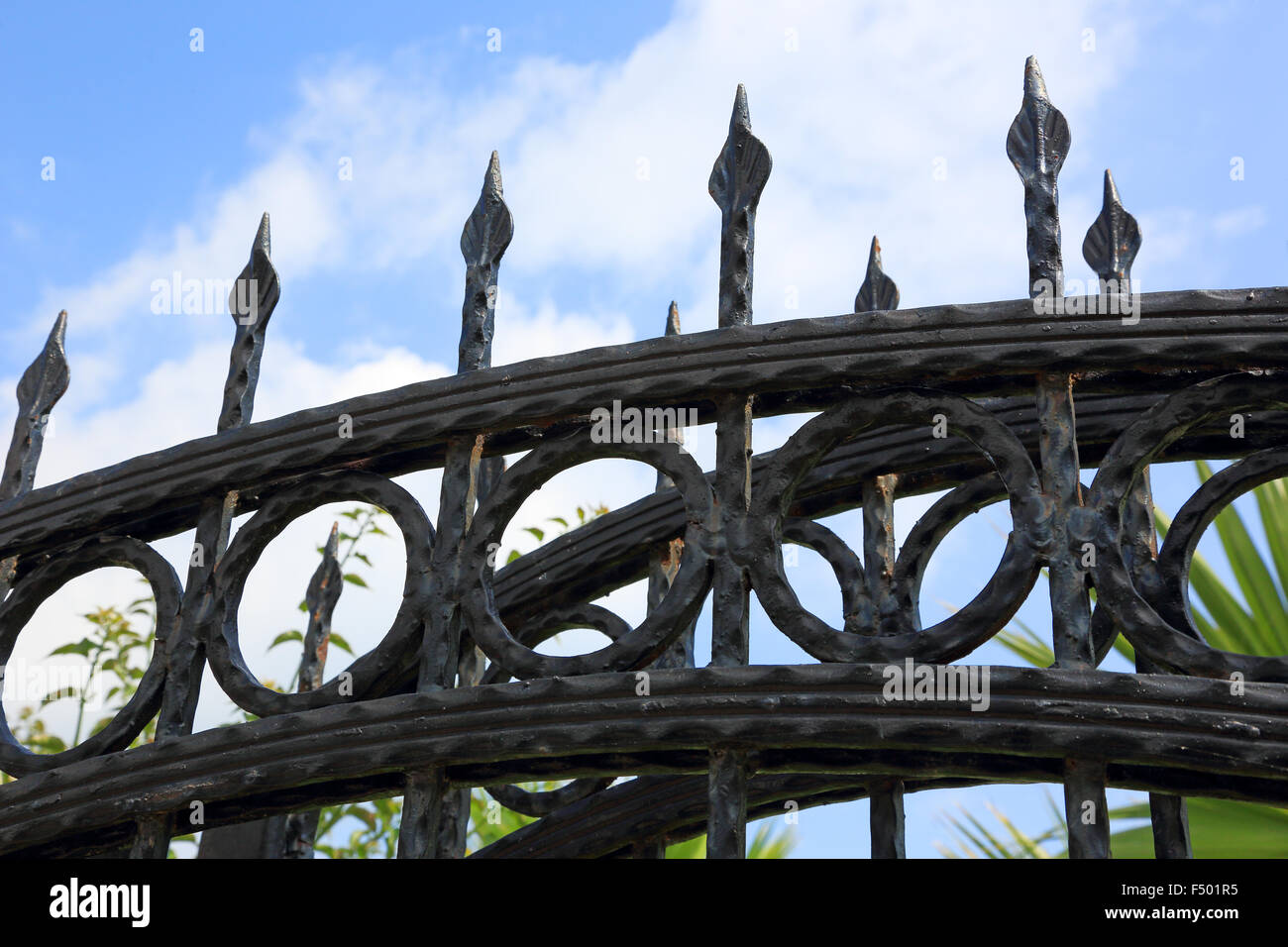sturdy iron fence with sharp peaks - Stock Image
