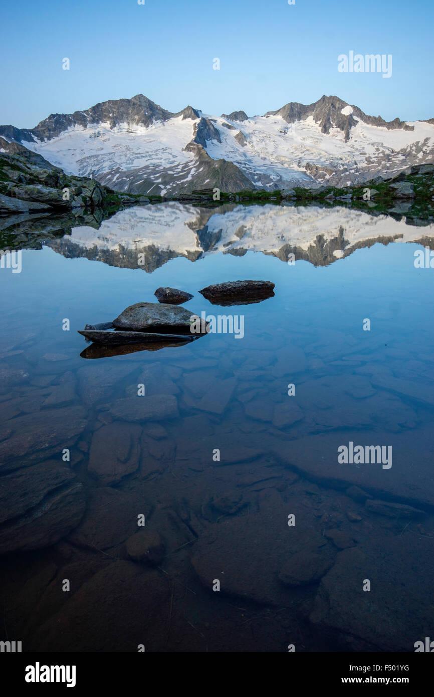 Schwarzsee lake in Zemmgrund, Ginzling behind, sunrise, Zillertal, Tyrol, Austria Stock Photo