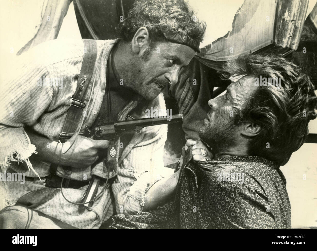 American actors Clint Eastwood and Eli Wallach in a scene from the film 'The Good, the Bad and the Ugly', - Stock Image