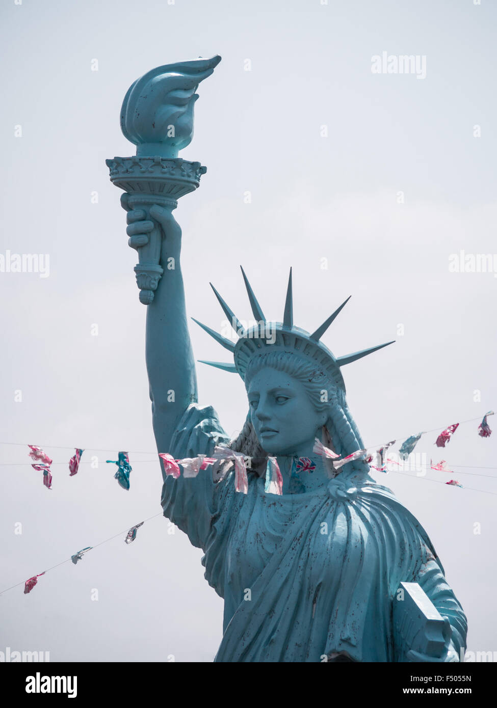 Choking lady liberty - ropes wrapped around the neck of a replica of the Statue of Liberty symbolize loss of power - Stock Image