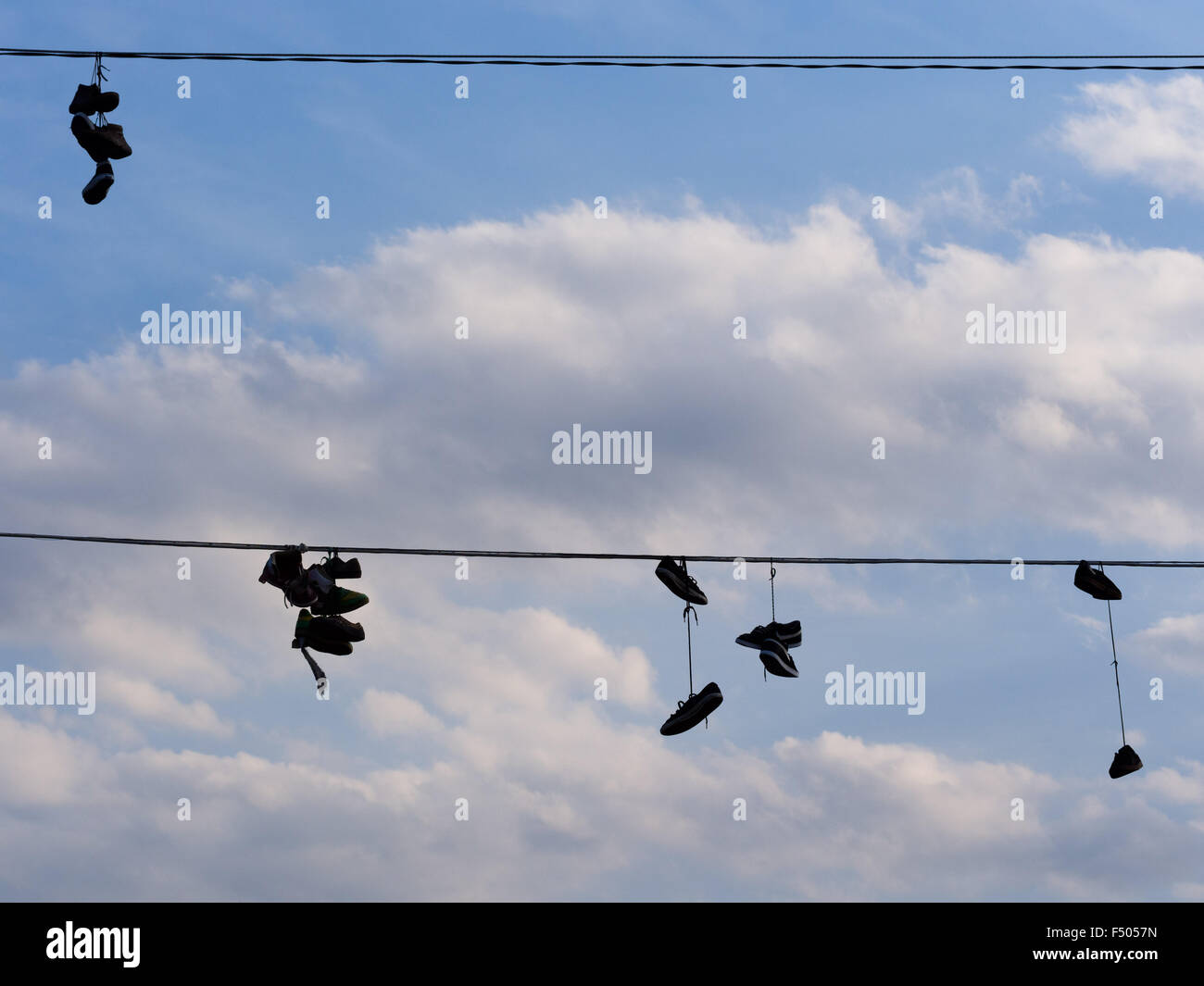 Shoes hanging from power lines by their laces Stock Photo: 89129257 ...