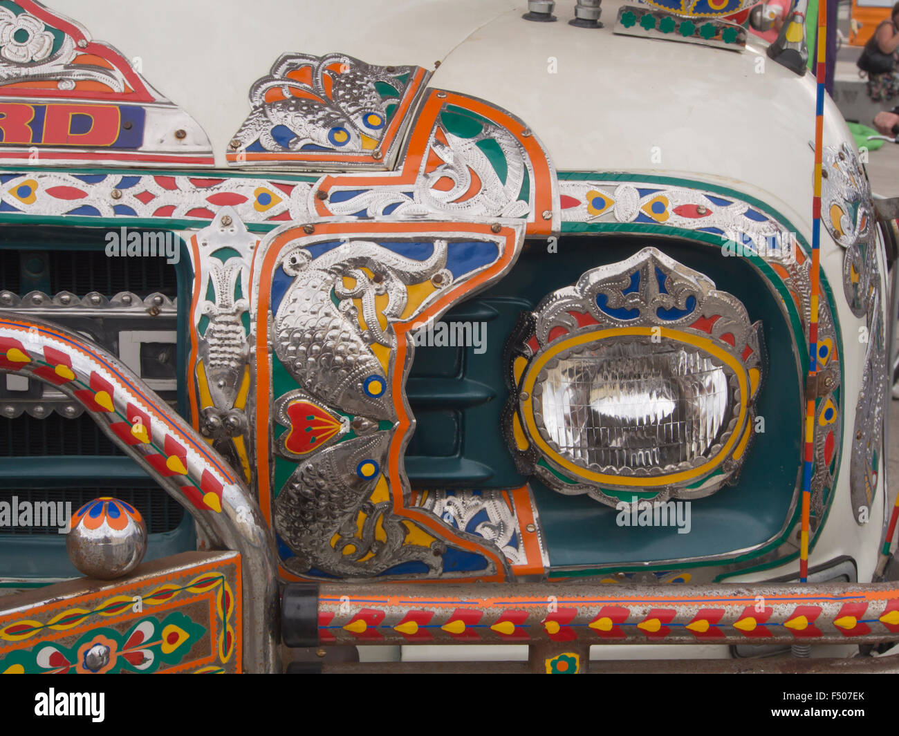 Details from an elaborate and artistically decorated colourful Bedford truck in Pakistani or Indian style, front - Stock Image