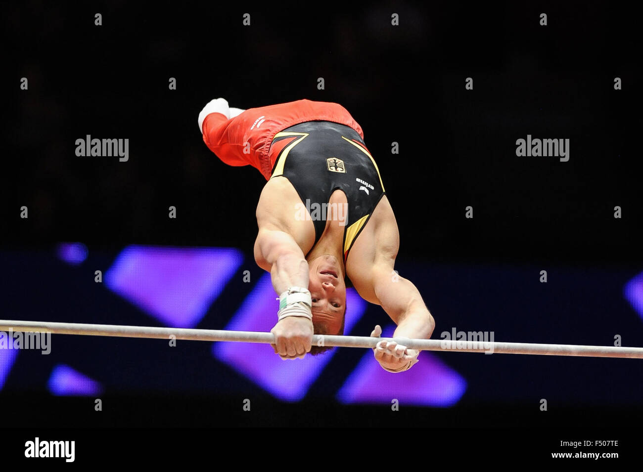 FABIAN HAMBUECHEN from Germany competes on the high bar during the preliminary round of the 2015 World Gymnastics - Stock Image