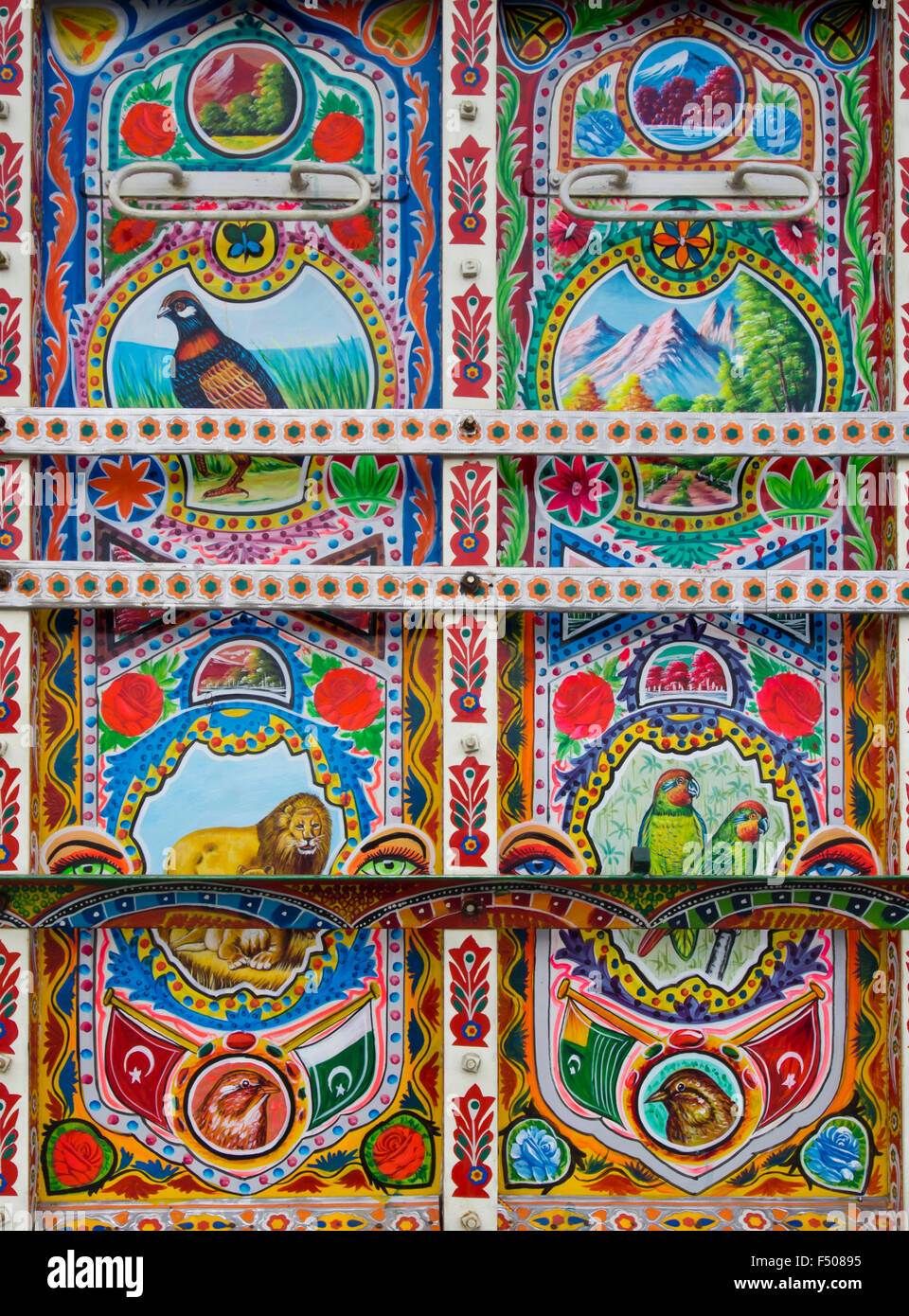 Details from an elaborate and artistically decorated colourful Bedford truck in Pakistani  style, animal motifs - Stock Image