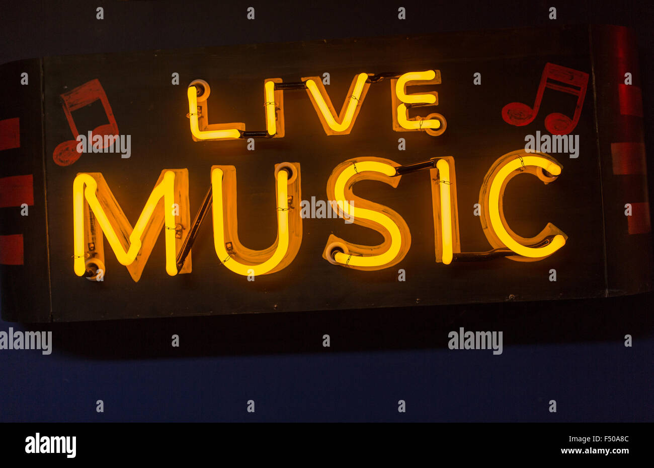 Neon sign promoting live music - Stock Image