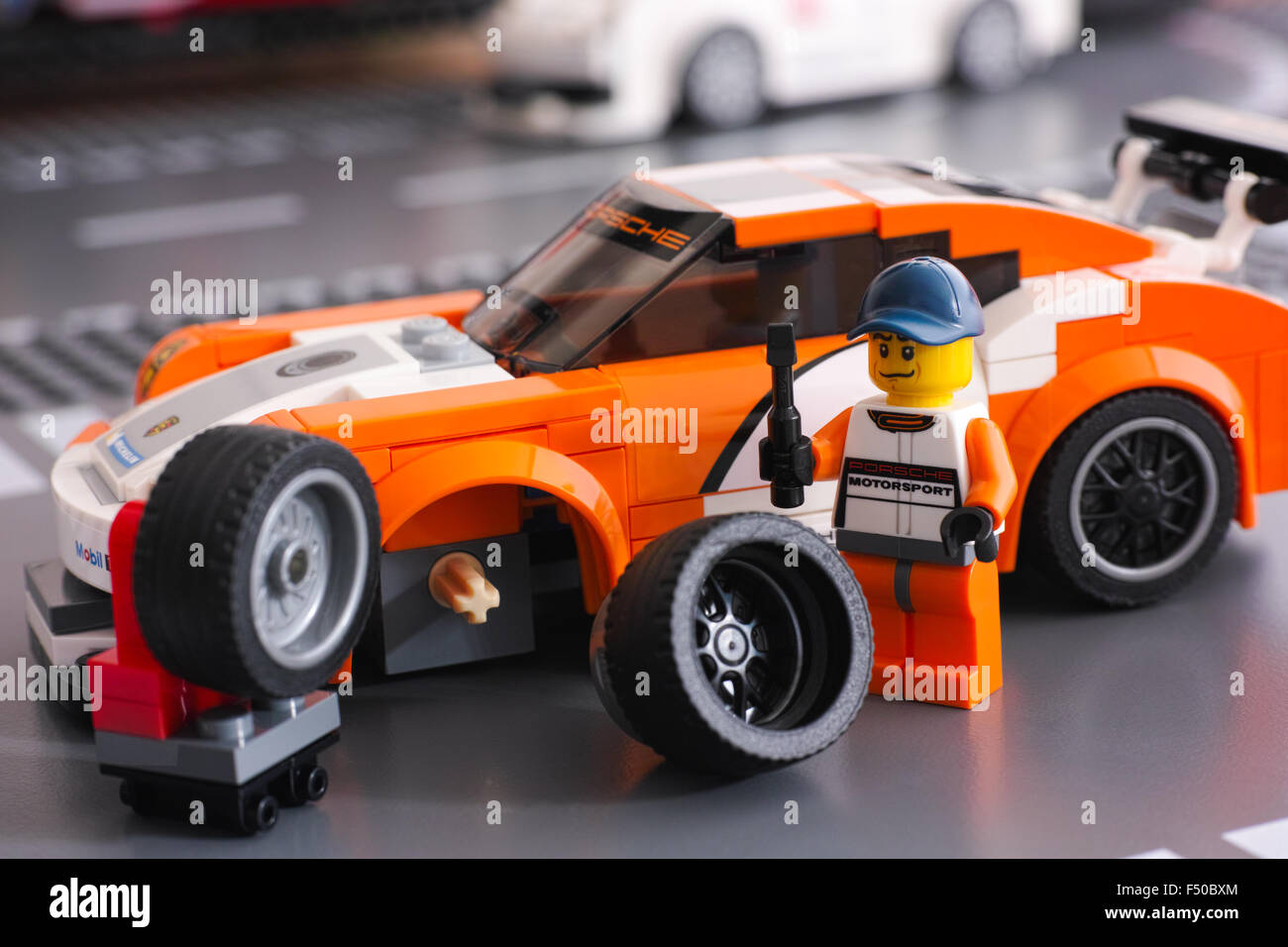 lego driver minifigure is fixing wheel of porsche 911 gt. Black Bedroom Furniture Sets. Home Design Ideas