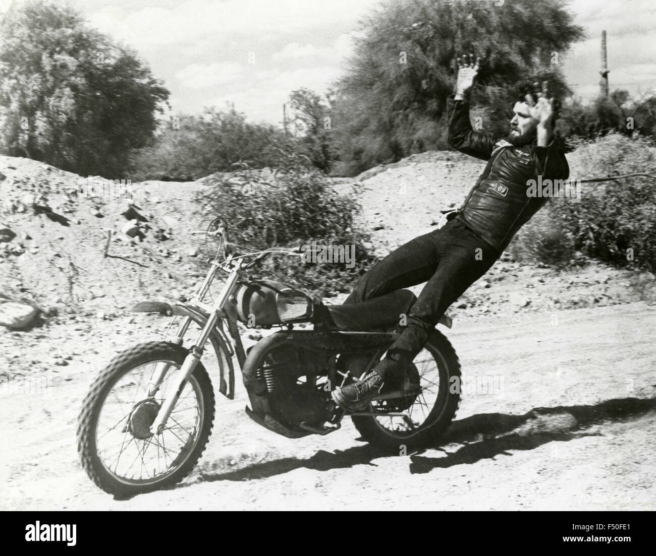 A stuntman is thrown from a motorcycle - Stock Image