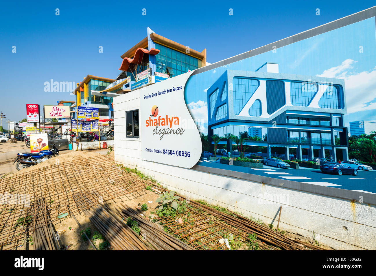 A big advertisement for a new office building with some new modern buildings in the distance - Stock Image