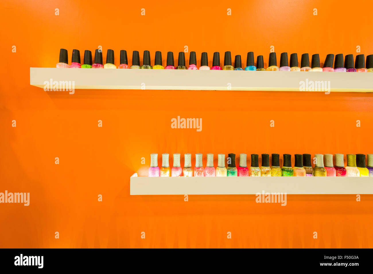 Nail polish is displayed for sale in one of the shops of the modern shopping mall Gulmohar Park - Stock Image