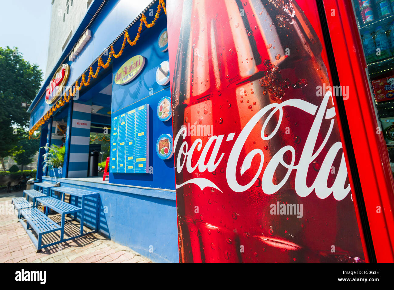A big advertisement for Coca Cola at the entrance of a new, western style restaurant - Stock Image