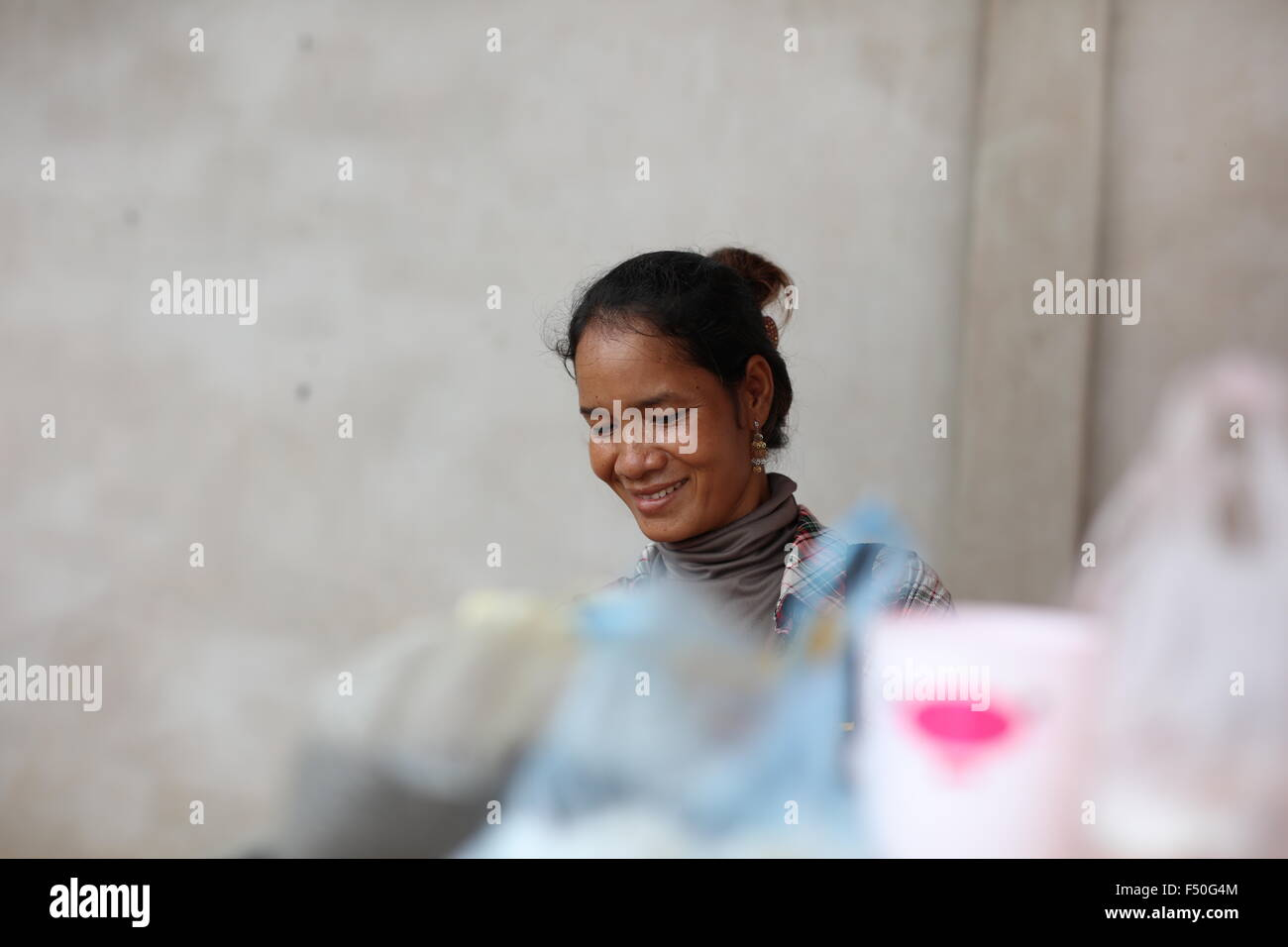 Portrait of Asian woman smiling - Stock Image