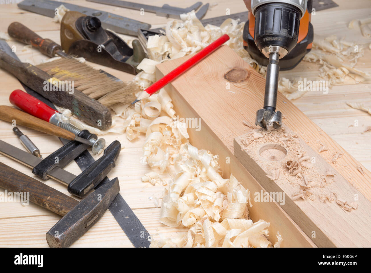 Carpentry Tools And Wood Shavings In The Furniture Workshop Stock