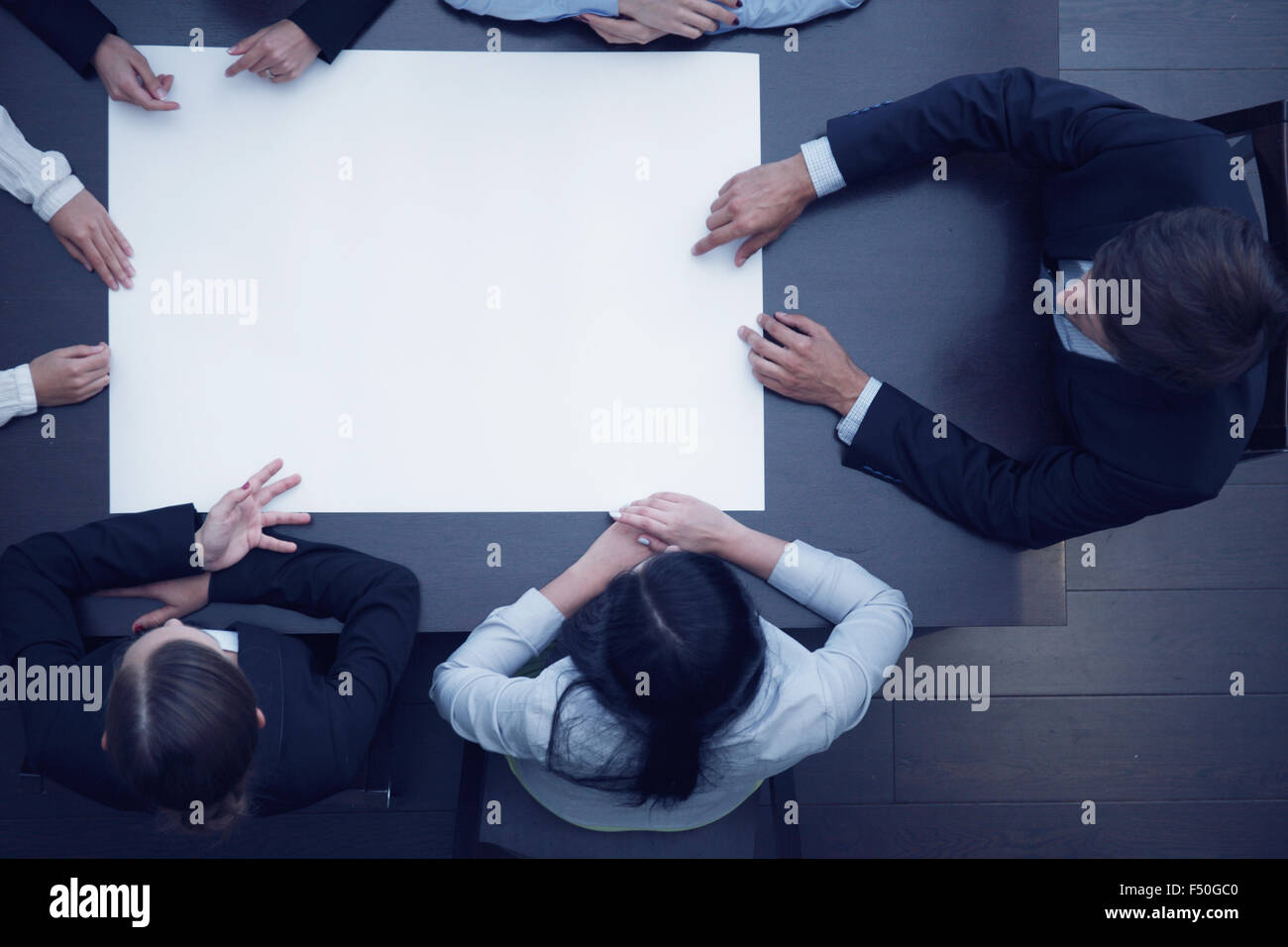 Group of business people with blank paper, new project concept - Stock Image