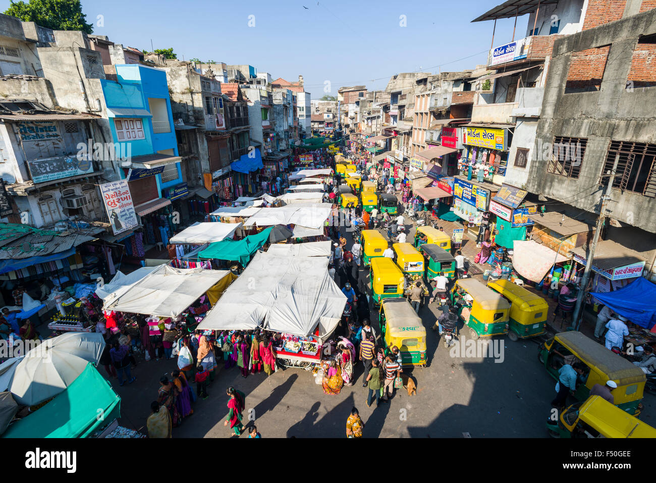 A crowded street with shops and traffic jam in the old city market area - Stock Image