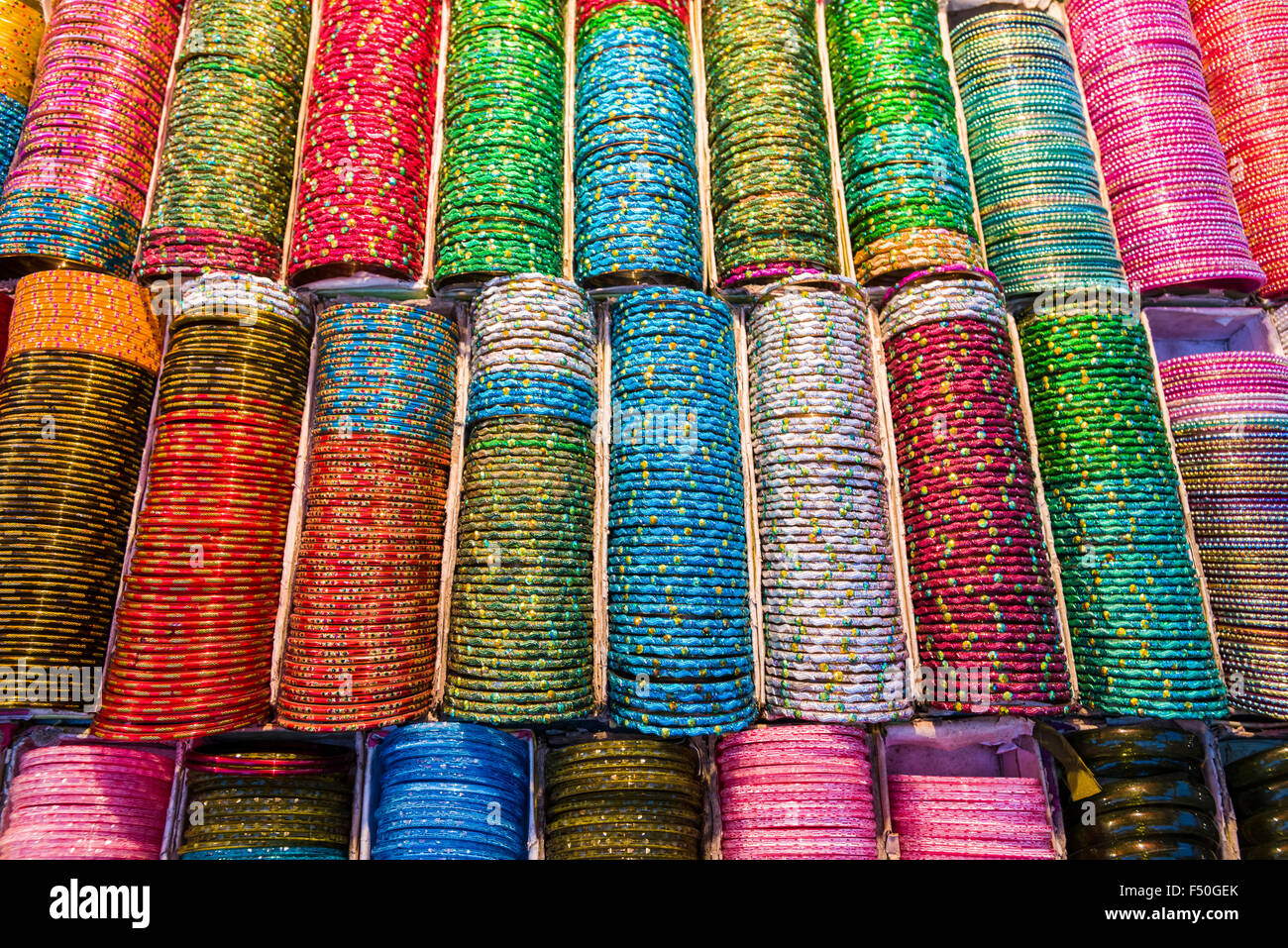 Colorful bangles, the traditional glas jewellery for women, are displayed for sale - Stock Image