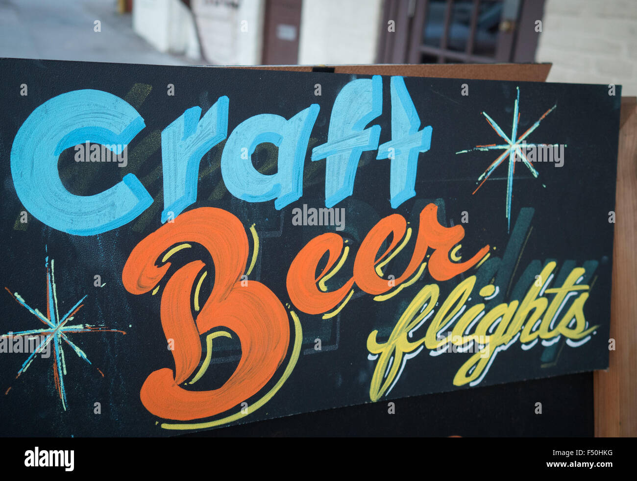 Craft beer flights sign outside of a bar in Austin, Texas - Stock Image
