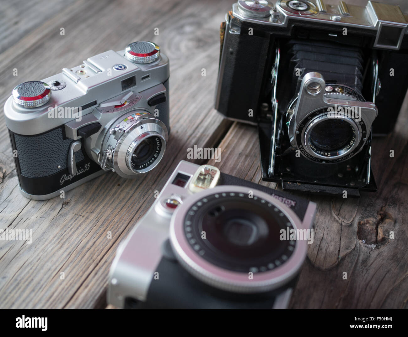 A collection of vintage and retro looking film cameras - Stock Image