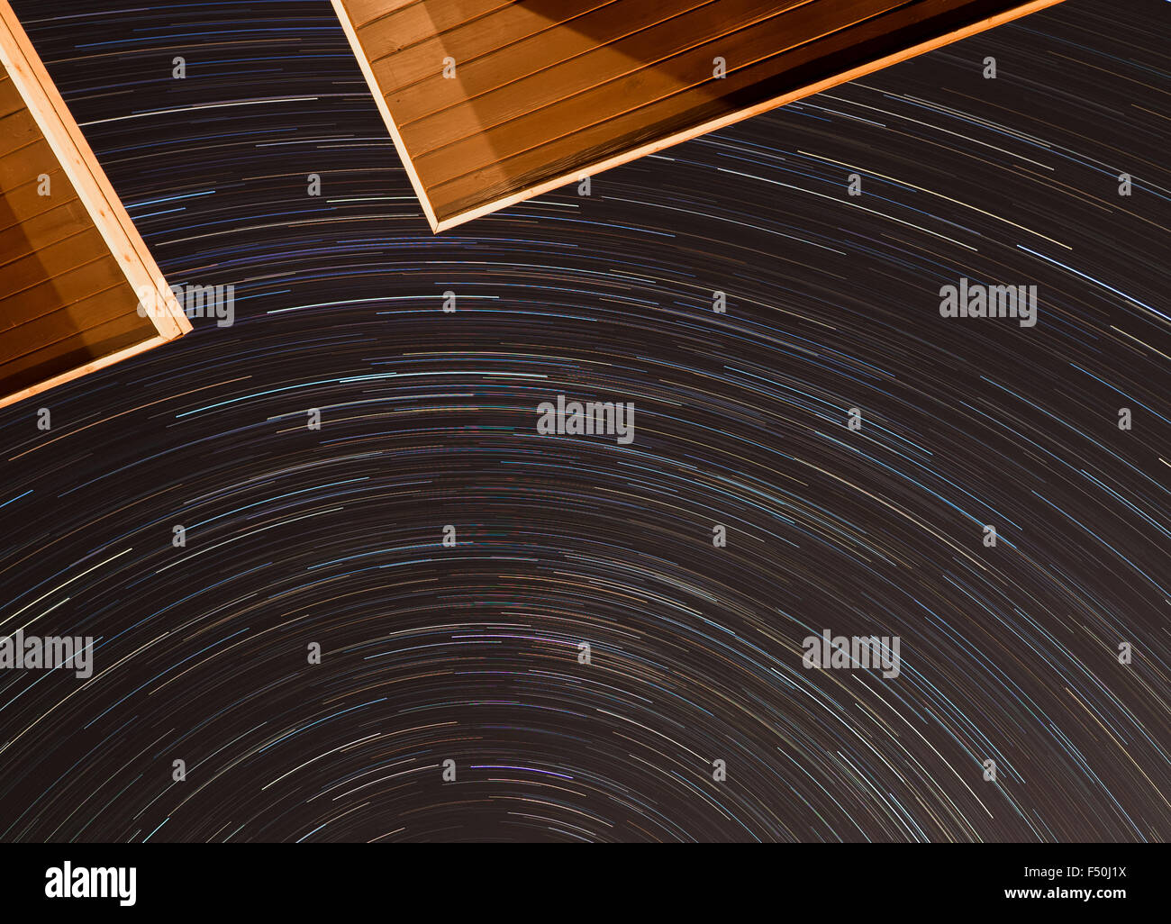 Star spin trails over the houses in Austin, Texas - Stock Image