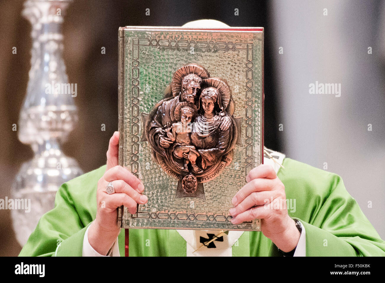 Vatican City. 25th Oct, 2015. Pope Francis holds the Book of Gospels as he celebrates a Mass in St. Peter's - Stock Image