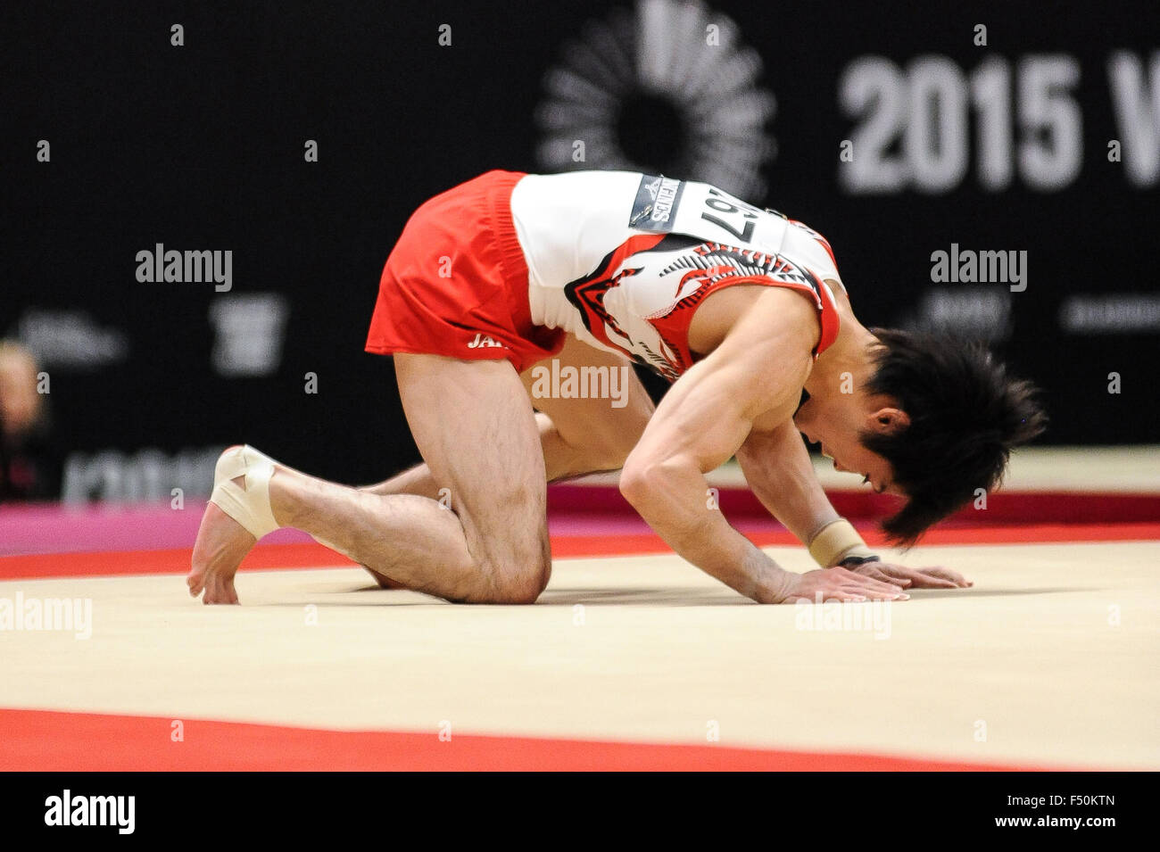 KOHEI UCHIMURA from Japan competes on the floor during the preliminary round of the 2015 World Gymnastics Championships - Stock Image