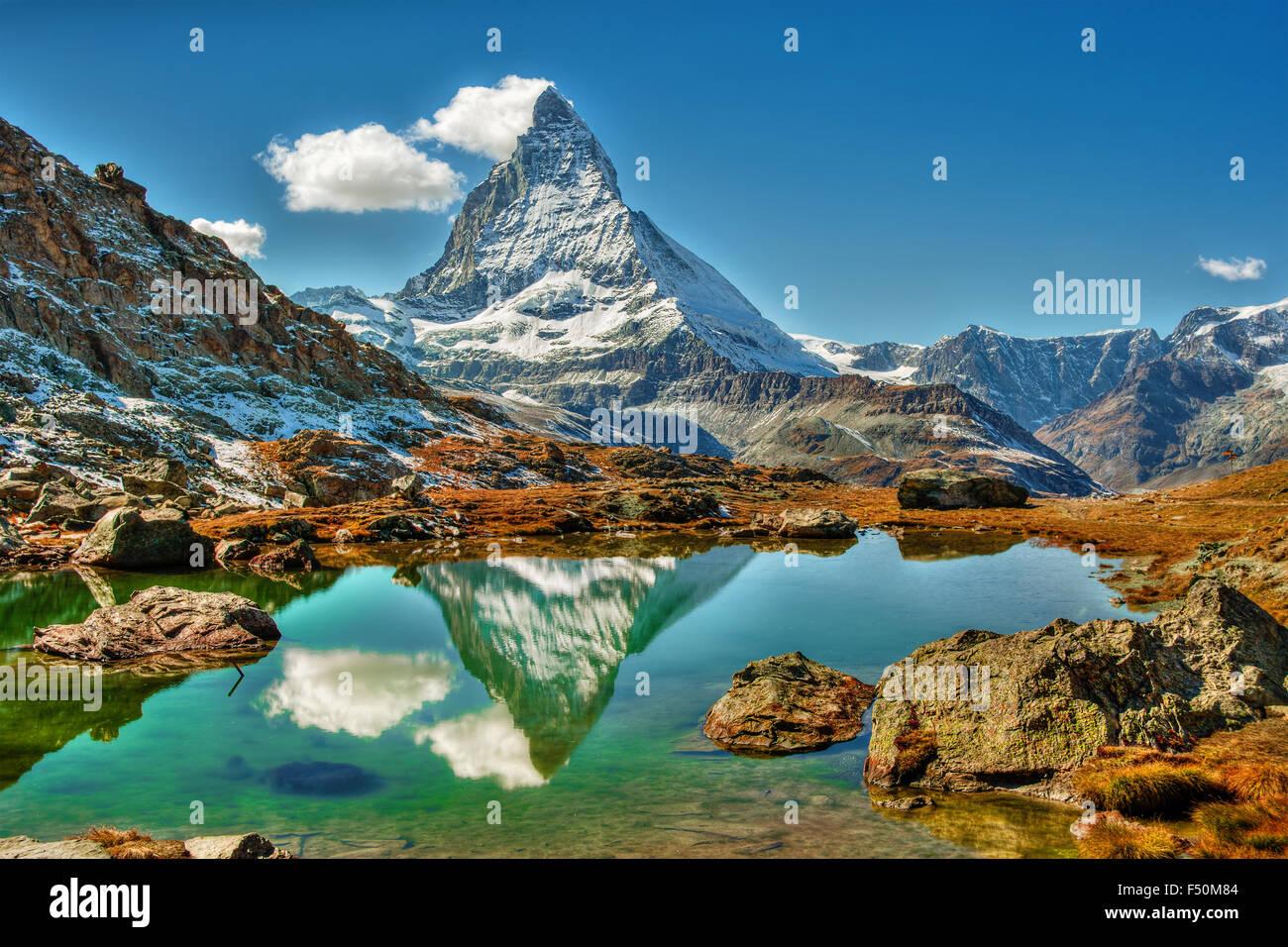 September 2015, the mountain Matterhorn in Zermatt (Switzerland) with its reflection in a alpine pond - Stock Image