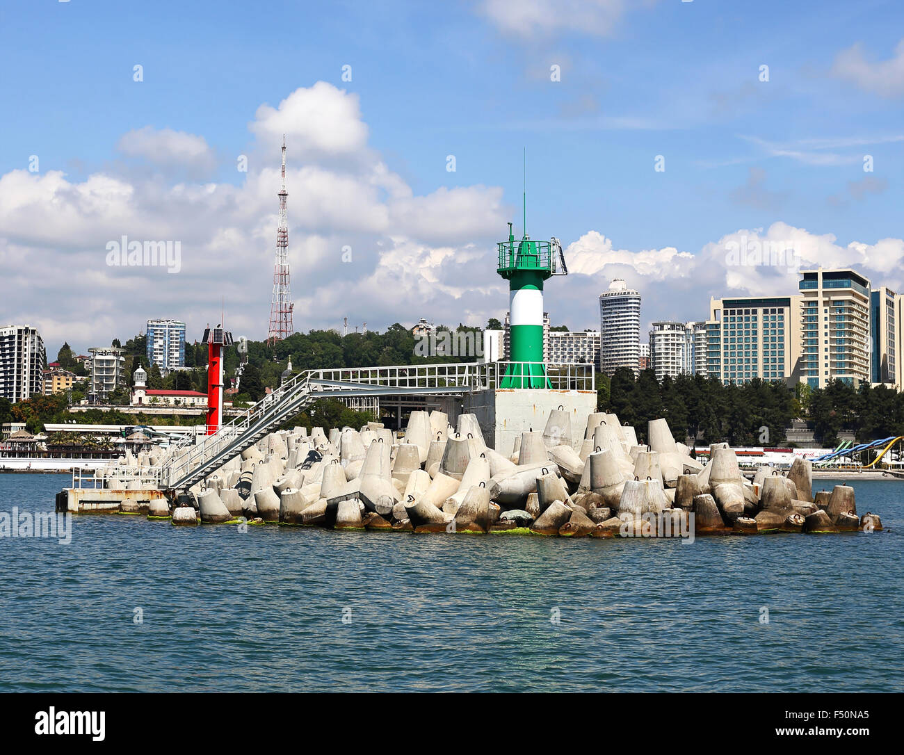 Lighthouse at the entrance to the sea bay in Sochi - Stock Image