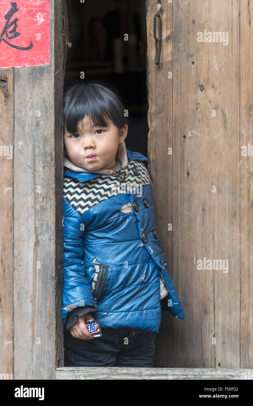 Small boy with Snickers bar, Shiqiao Miao Village, Guizhou Province, China - Stock Image