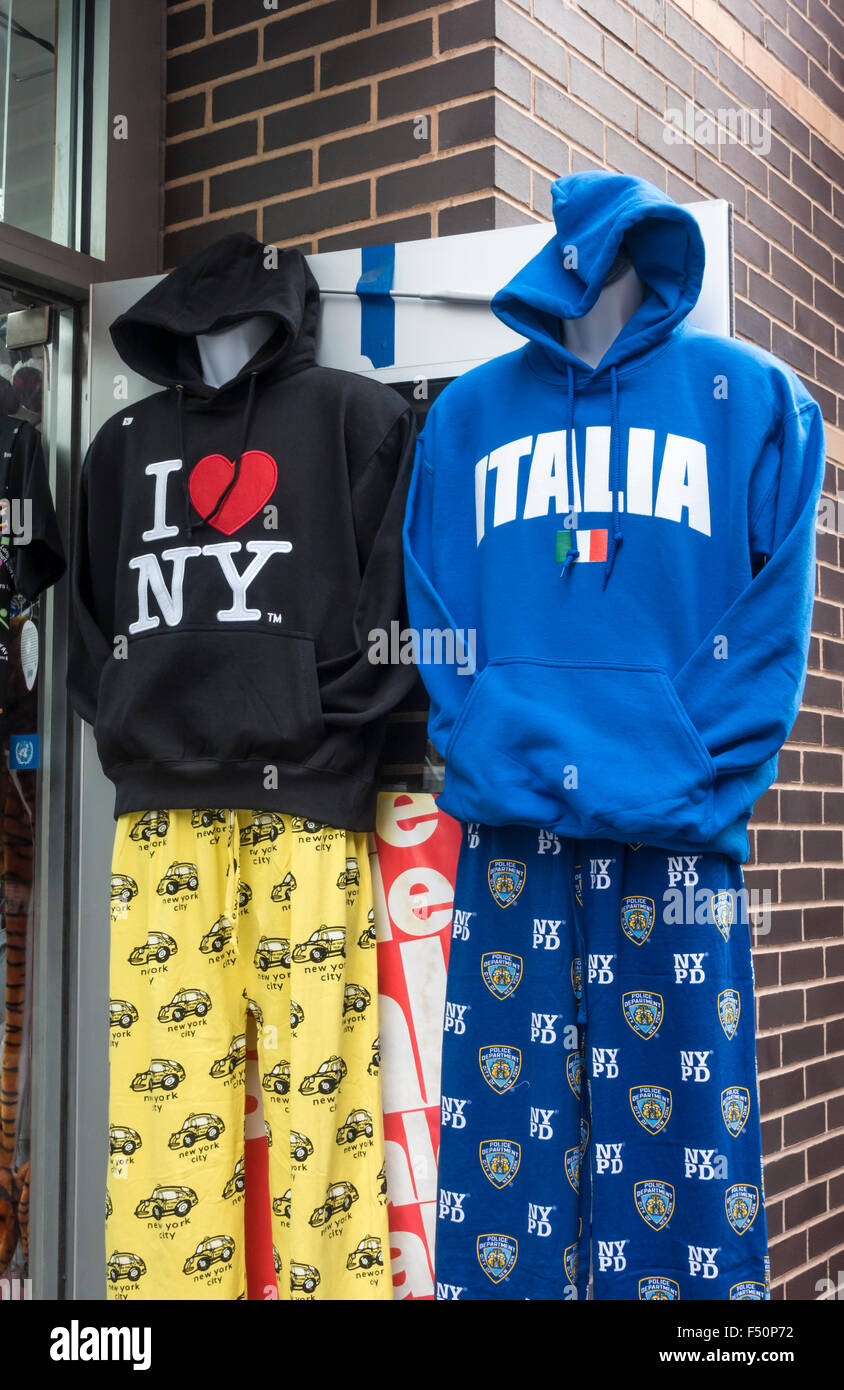 Souvenir hoodies outside a shop in Little Italy in New York City - Stock Image