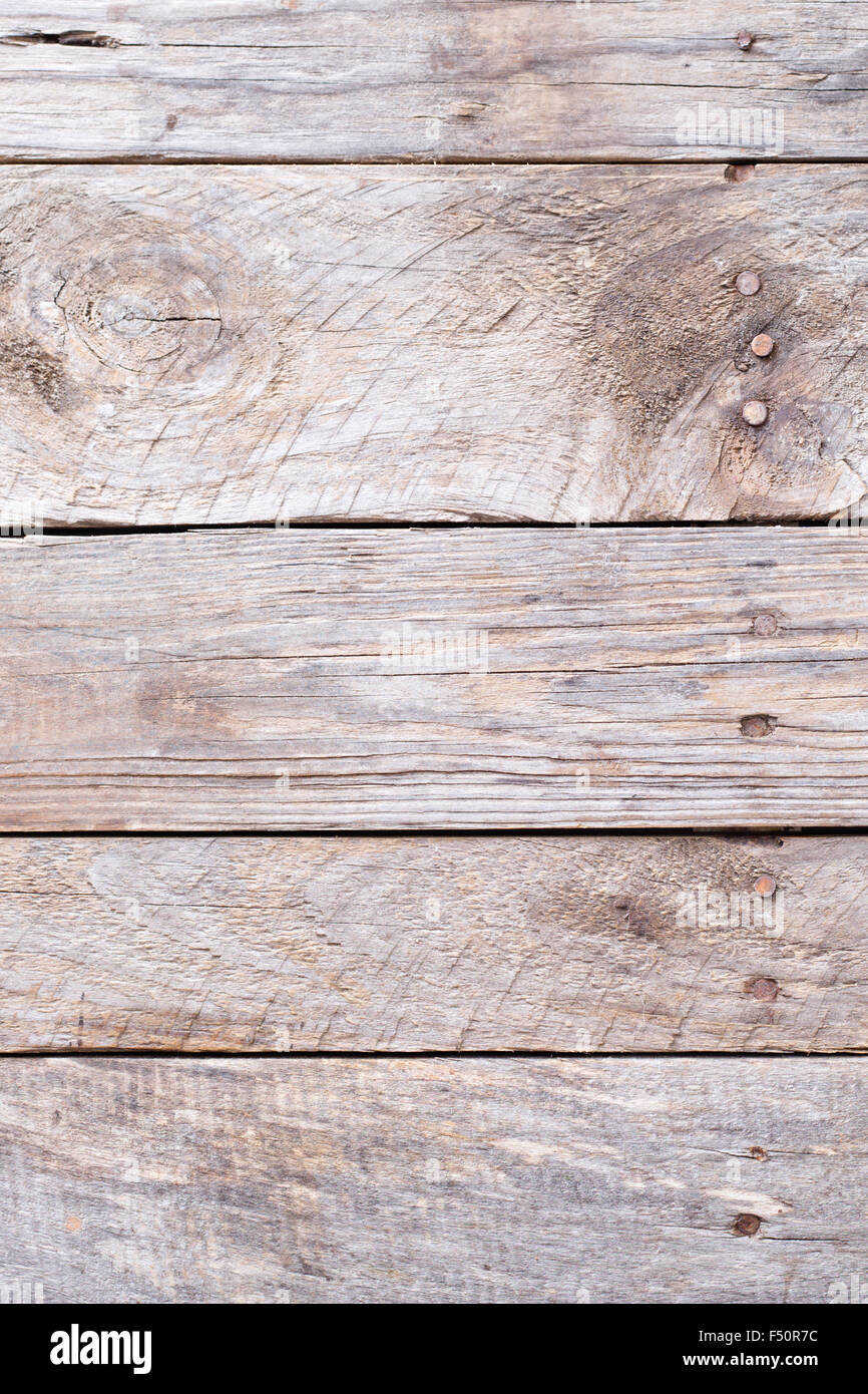 Wooden rustic background with planks and nails - Stock Image