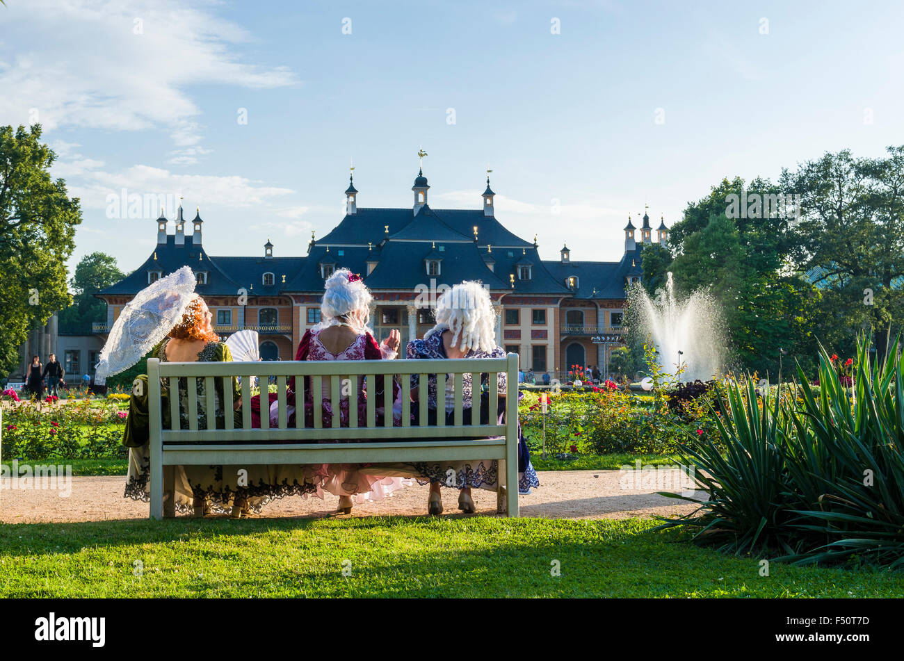 Baroque style dressed actors at Pillnitz Castle, situated 12 km out of the City at the river Elbe - Stock Image
