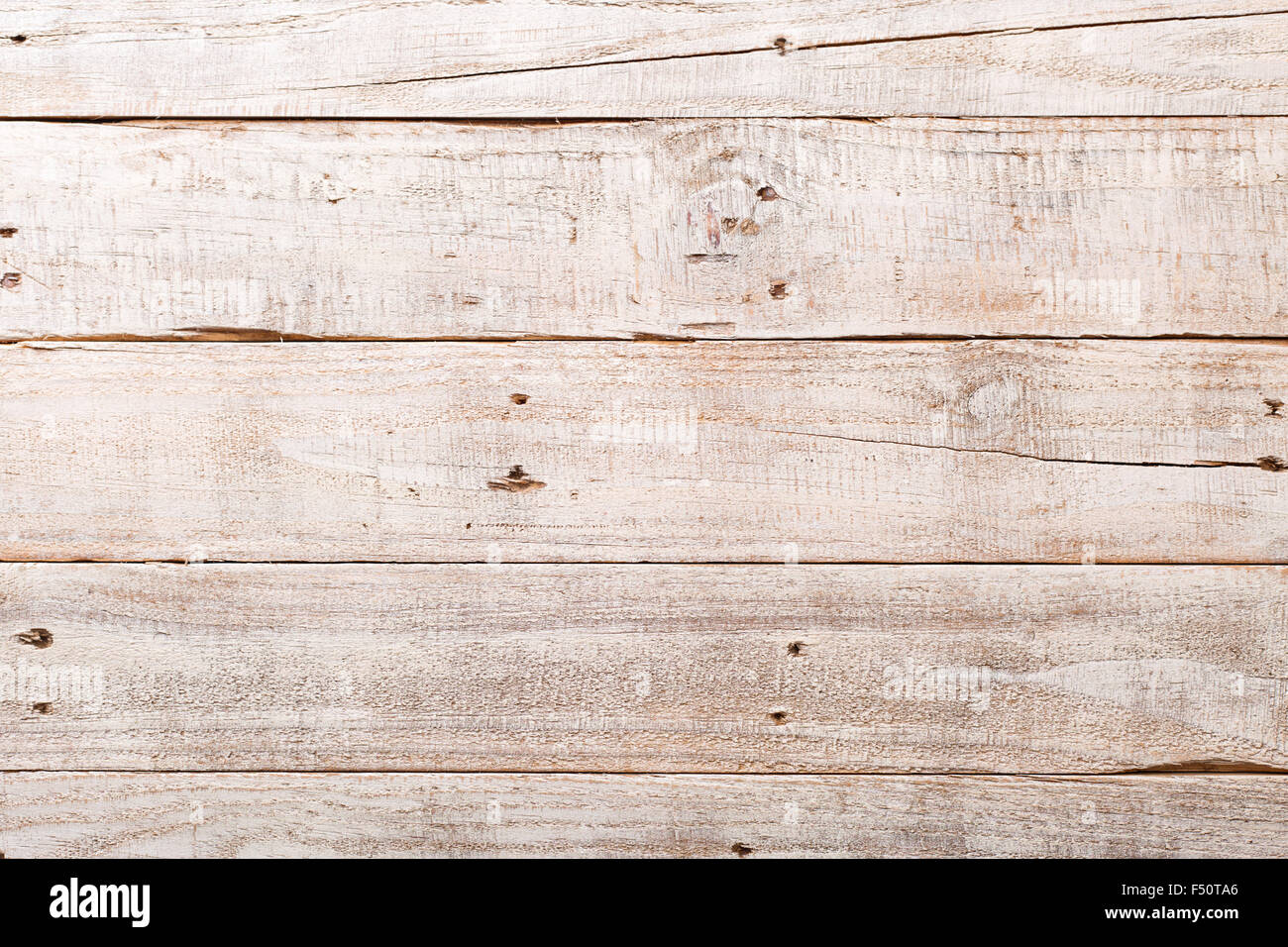 White wooden rustic background with planks and nails - Stock Image