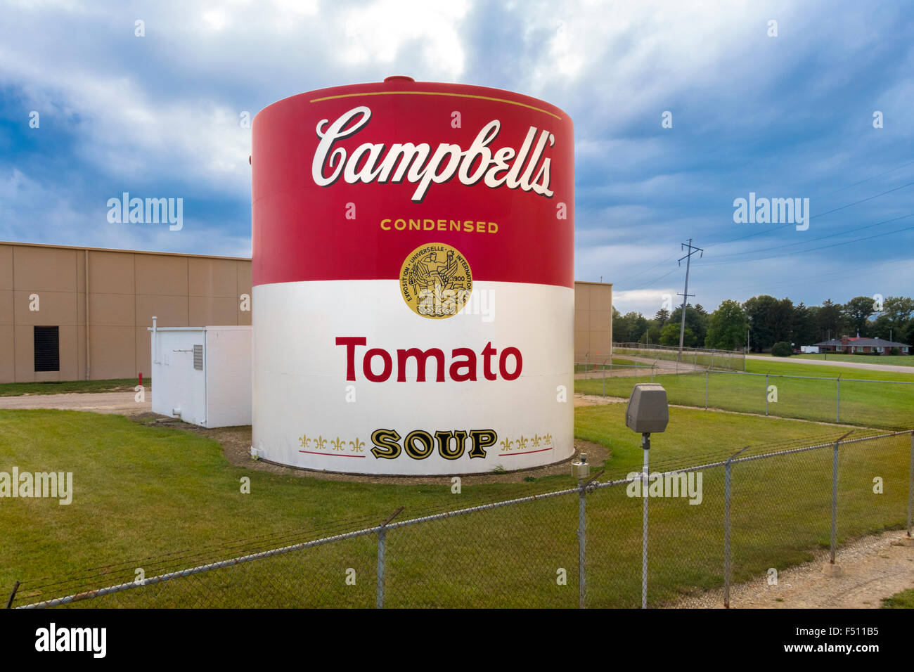 Giant Tomato Soup Can outside Campbell's Soup Supply Co factory in Napoleon Ohio US - Stock Image